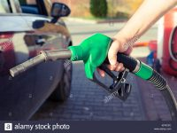 man-hand-holding-gasoline-pump-in-a-gas-station-ready-to-fill-the-KFRCFC